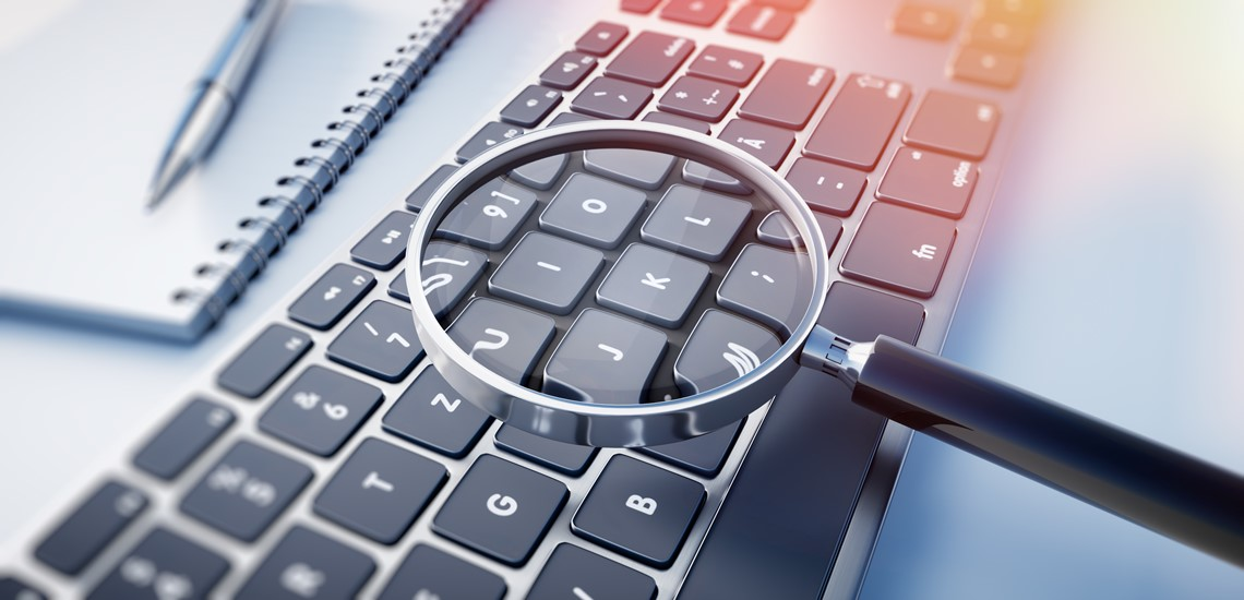 A magnifying glass over a keyboard